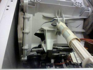 Поврежденный бак стиральной машины Candy